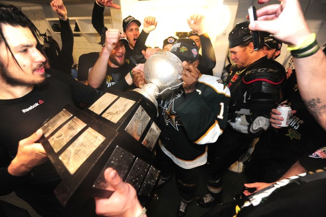 Maxime Fortunus drinks from the Calder Cup.