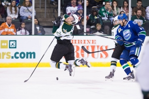 Travis Morin is high-sticked in the third period of Texas 4-3 loss to Utica. (Photo by Christina Shapiro/Texas Stars)