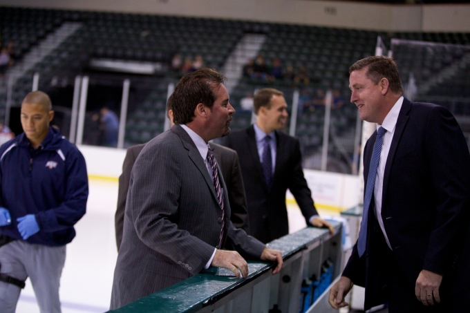 Todd Nelson and Derek Laxdal talk before a pre-season game between the Stars and Barons. (Photo by Christina Shapiro/Texas Stars)