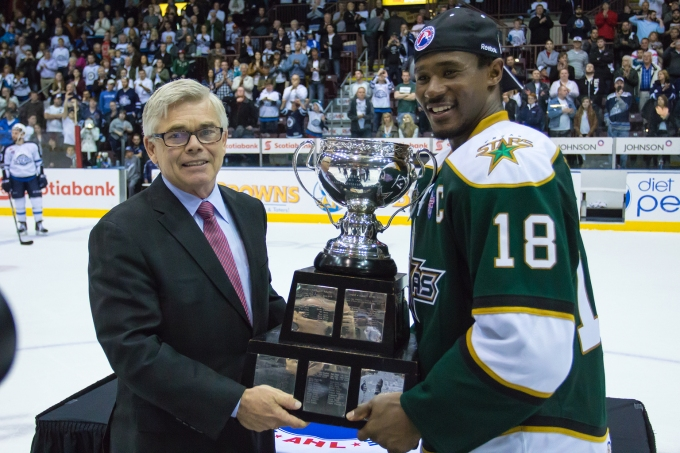 Dave Andrews presents the Calder Cup to Maxime Fortunus after Game  5 of the Calder Cup Finals. (Photo courtesy of the AHL)