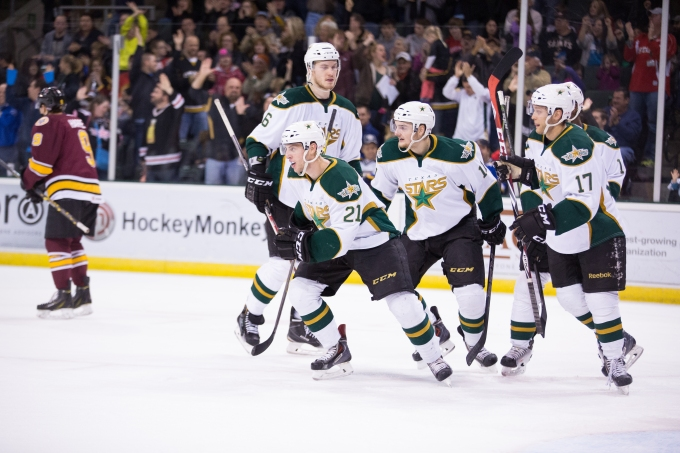 Jesse Root, Branden Troock, and Eric Faille celebrate Root's goal in the second period. (Photo by Christina Shapiro/Texas Stars)