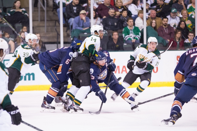Gemel Smith is sandwiched while he fights for a face-off late in the third period of a 3-2 loss to the Oklahoma City Barons. (Photo by Christina Shapiro/Texas Stars)