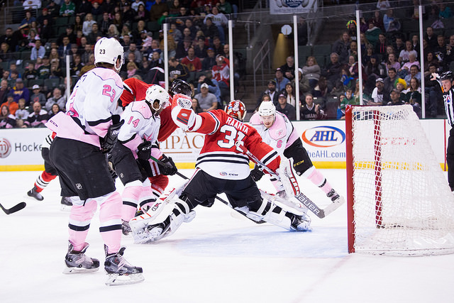 Antti Raanta makes a save against Jamie Oleksiak in the second period of a 6-3 victory for the Rockford IceHogs. (Photo by Christina Shapiro/Texas Stars)