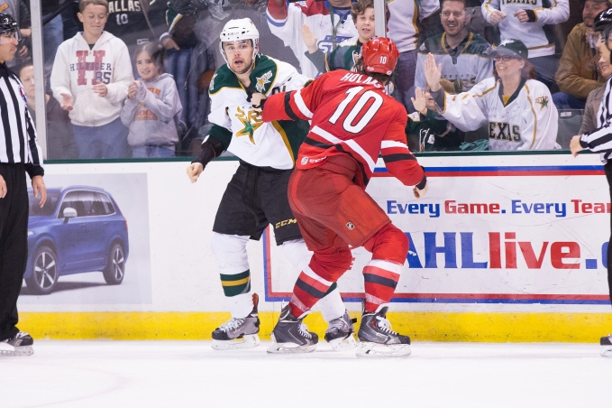 Cameron Gaunce fights against Charlotte's Ben Holmstrom on Jan. 31. (Photo by Christina Shapiro/Texas Stars)