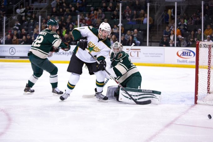 Texas Stars left wing Kevin Henderson chases the puck during an overtime loss to Iowa last week. After being slowed by injuries and illness in the early part of the season, Henderson has scored three goals in the past six games. CREDIT: Christina Shapiro/Texas Stars