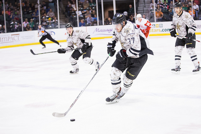 Valeri Nichushkin carries the puck up ice against the Grand Rapids Griffins. (Photo by Christina Shapiro/Texas Stars)