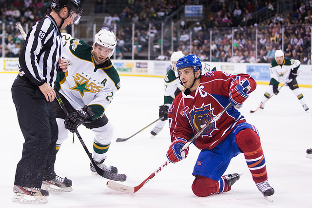 Travis Morin battles for a face-off against Hamilton on Friday. (Photo by Christina Shapiro/Texas Stars)
