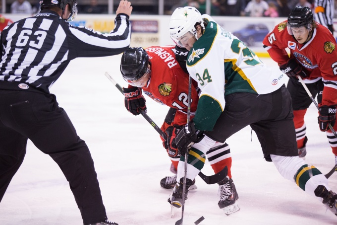 Devin Shore and Dennis Rasmussen fight for a face-off in Game 1. (Photo by Christina Shapiro/Texas Stars)