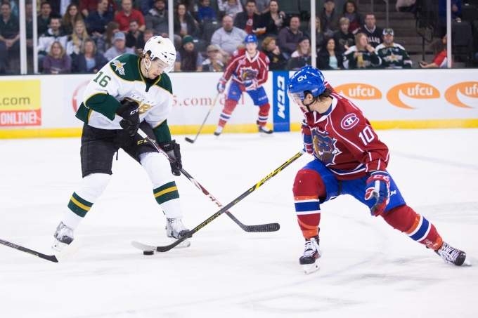 Charles Hudon, who was on our ballot, battles with 2014 AHL Rookie of the Year Curtis McKenzie. (Photo by Christina Shapiro/Texas Stars)