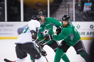 Jordie Benn, right, has been impressed with Magee's play in camp. (Photo by Christina Shapiro/Texas Stars)