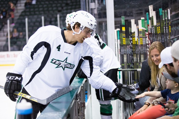 Stephen Johns interacts with a young fan before the Texas Stars preseason game last week. (Photo by Christina Shapiro/Texas Stars)