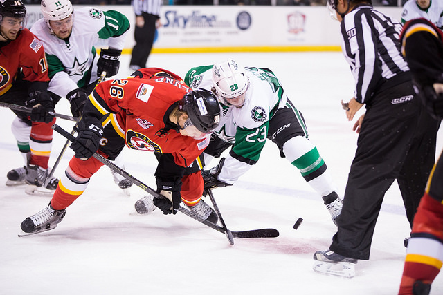 Travis Morin battles for a face-off in the Texas Stars 5-3 loss to Stockton. (Photo by Christina Shapiro/Texas Stars)
